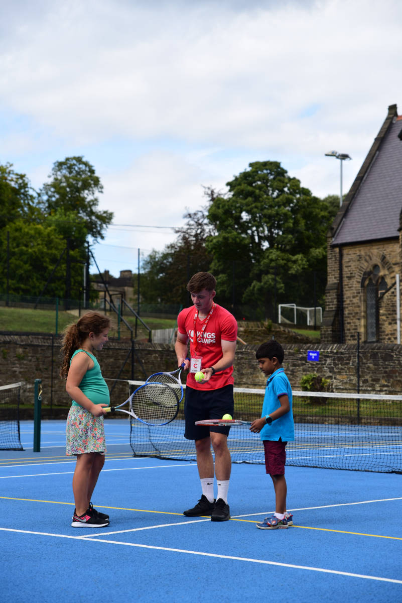 Sports coach with children
